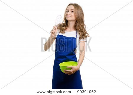 Woman in apron with bowl and whisk on white background isolation