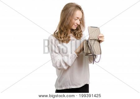 Beautiful girl with a lacquer bag on a white background isolation