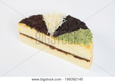 Healthy cheese cake whole topped with chocolate sprinkles, grated cheese, oreo chocolate cookies, and matcha green tea and chocolate filling.