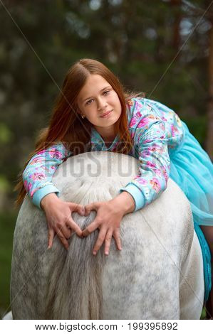 Redhead Girl And White Horse In The Forest