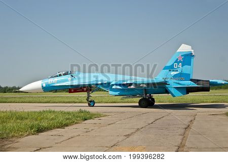 VORONEZH, RUSSIA - MAY 25, 2014: Russian military aircraft Su-27 (RF-92211) is taking off from the airfield Baltimore