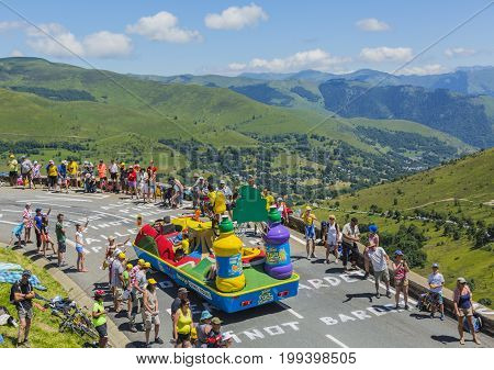 Col de PeyresourdeFrance- July 23 2014: Teisseire vehicle during the passing of the Publicity Caravan on the road to Col de Peyresourde in Pyrenees Mountains in the stage 17 of Le Tour de France on 23 July 2014.Teisseire produces fruit juices and syrups f