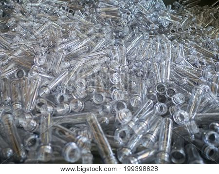 rows of empty plastic bottles at bottling plant. Production of small bottle line