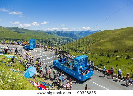 Col de PeyresourdeFrance- July 23 2014: Krys vehicles during the passing of the Publicity Caravan on the road to Col de Peyresourde in Pyrenees Mountains in the stage 17 of Le Tour de France on 23 July 2014.Krys is a major chain of optical stores in Franc