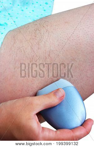 A woman sitting using a depilatory depilator. Smooth legs. Female epilating epilator for hair electric ,  belonging to the european race.