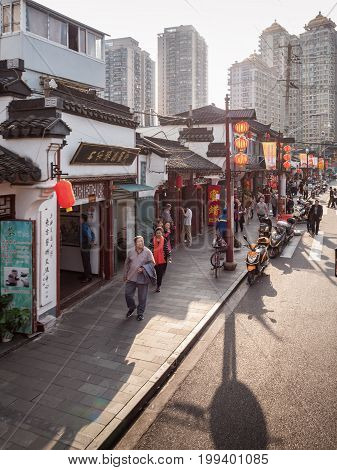 Shanghai, China - Nov 6, 2016: Fangbang Middle Road - Buildings with faithfully restored traditional Chinese architectural designs. Old Shanghai view captured from a double-decker public bus.