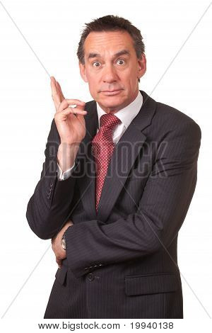 Middle Age Businessman in Suit with Surprised Expression