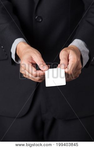 A Businessman showing his name card on his hands