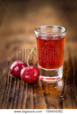 Cherry Liqueur On Wooden Background; Selective Focus