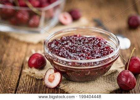 Wooden Table With Cherry Jam, Selective Focus