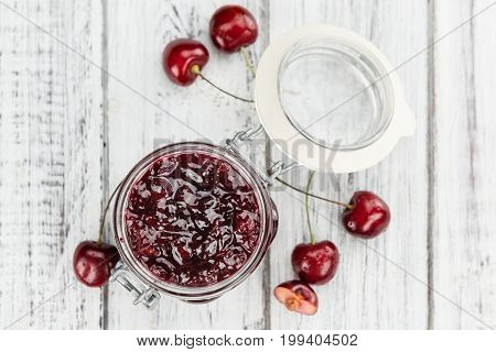 Fresh Made Cherry Jam On A Rustic Background