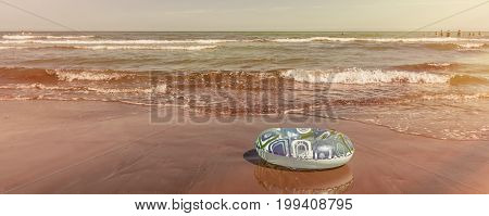 Lifebuoy on the shore, warm sea beach