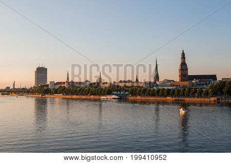 Old town of Riga summer sunset skyline with Daugava river