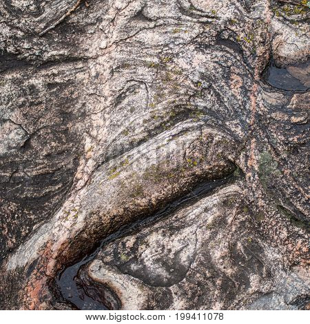 surface of old granite stones.brown gray pink