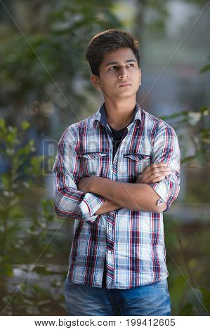 Confident mature businessman posing with arms crossed and looking at camera