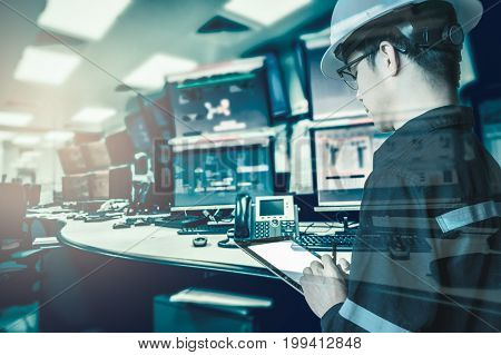 Double exposure of Engineer or Technician man in working shirt working with tablet in control room of oil and gas platform or plant industrial for monitor process business and industry concept