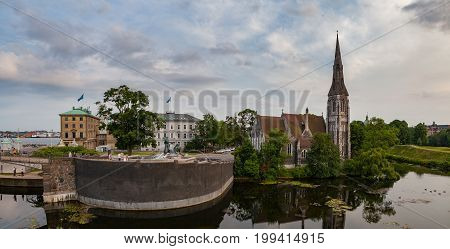 Sunset panoramic view on the St. Alban's Church and the pond in Copenhagen, Denmark