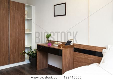Wooden Table In The Bedroom For Working Or Reading In Condominium.