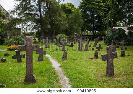 Ancient stone crosses at old castle cemetery. The Nortern Europe.