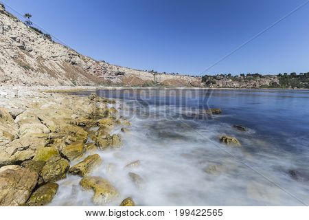 Lunada Bay with motion blur water in the Palos Verdes Estates area of Los Angeles County, California.