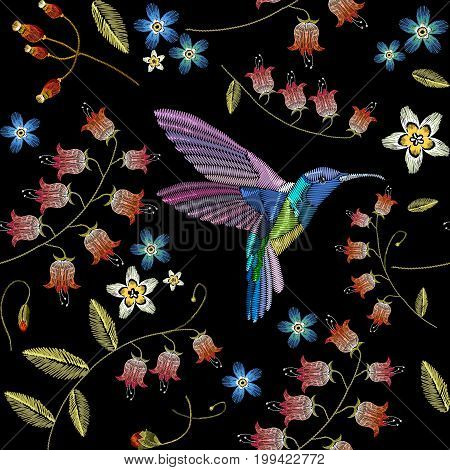 Embroidery flowers and humming birds seamless pattern. Fashionable template for design of clothes. Beautiful chamomiles cornflowers tropical birds classical embroidery seamless background