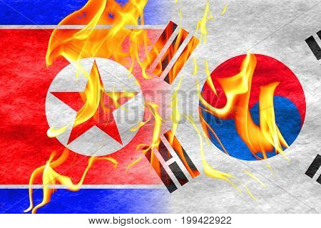 North korea flag fading into south korea flag with flames in front korean conflict concept