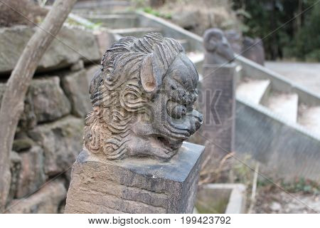 The ancient Chinese black stone carving of a lion's head.