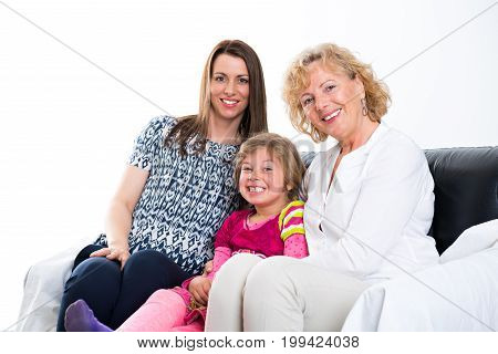 Woman With Daughter And Grandchild  In Front Of White Background
