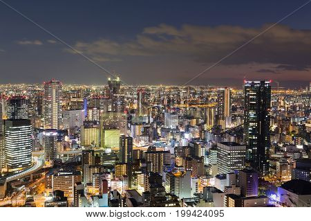 City downtown night lights Osaka cityscaepe background Japan
