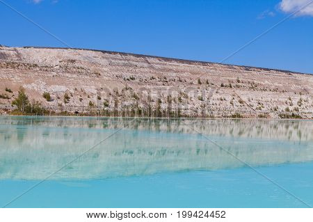 Amazing color of artificial lake and ash dunes of power plant waste area