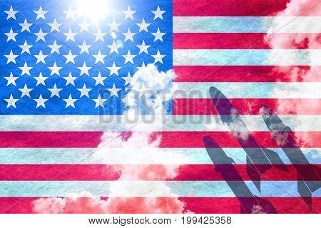 American flag shining through a sunny blue sky background and 3 missiles starting from the right