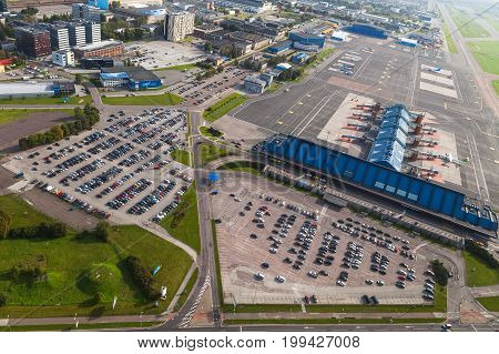 TALLINN, ESTONIA - AUGUST, 15, 2016: Aerial view of airport terminal and gates with suburbs