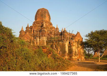 One of the pagodas of the ancient Buddhist temple Tha Kya Pone at dawn. Bagan, Burma