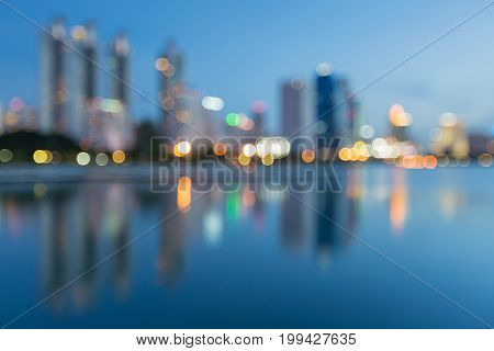 City office building blurred light with reflection during twilight abstract background