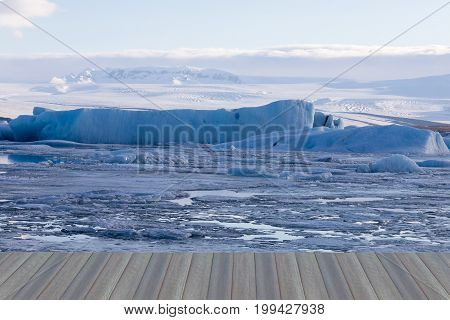 Opening wooden floor Ice on water lake winter season natural landscape background Iceland