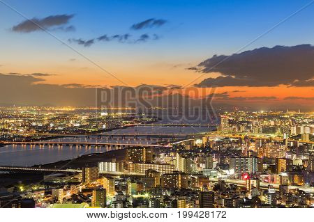 Night lights Osaka city business downtown aerial view Japan