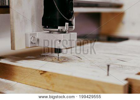 close up of cutting wood on a CNC milling machine