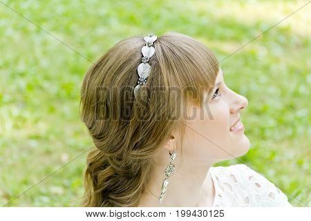 Profile of bride with diadem in the summer time