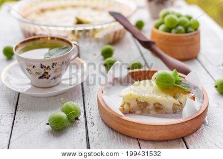 tasty and fresh homemade gooseberry pie on white wooden background