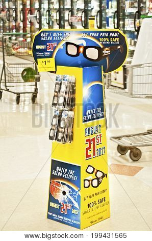 OREGON,USA-AUGUST 12, 2017: Solar Eclipse glasses for sale displayed on stand in Fred Meyer grocery department.