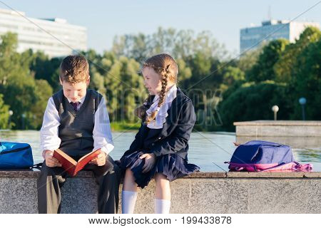 The boy from the school reads the book the girl asks his name the attitude of the students