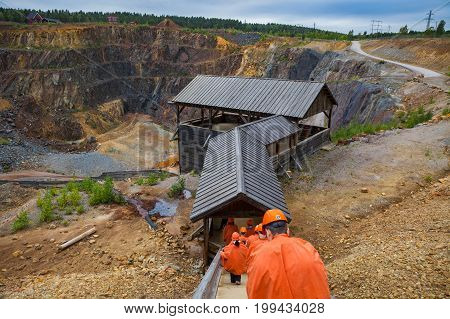FALUN, SWEDEN - SEPTEMBER 20, 2016: Mining Area of the Great Copper Mountain - UNESCO World Heritage Site. People start excursion.