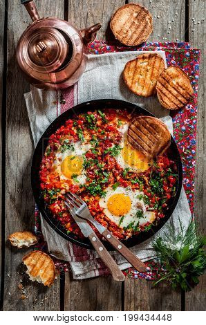 Shakshouka Middle East and North Africa Dish of Poached Eggs in a Sauce of Tomatoes Chili Peppers and Spices top view