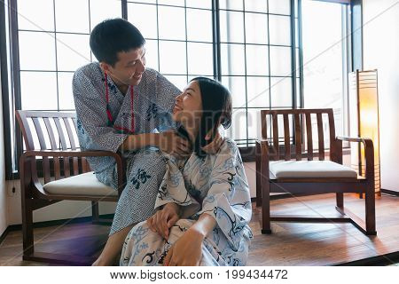 an asian couple wearing japanese clothes in the japanese-style room feeling happy from their love