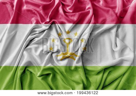 Ruffled waving Tajikistan flag national flag close