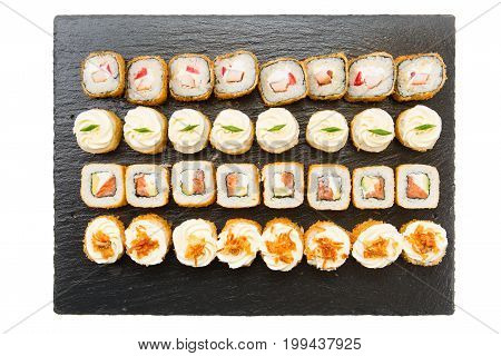 Set Of Sushi Rolls On A Black Background. Top View