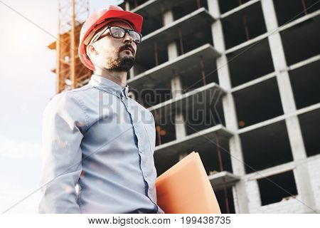 Business Man And Construction Engineer Manage Building. Architect In Glasses And Hard Hat On Constru