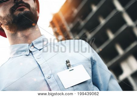 Close Up Portrait Of Businessman Builder With Empty Blank Badge Or Name Card On Chest Of His Shirt