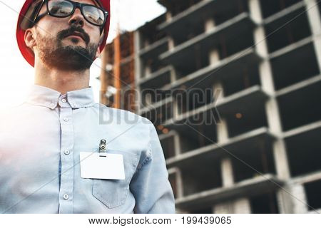 Portrait Of Young Bearded Architect Man With Blank Badge Or Pocket Of His Shirt