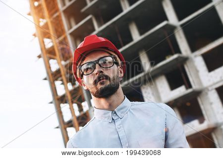 Portrait Young Modern Bearded Engineer Or Architect On Background Of Building Construction